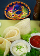 Mexican vegetarian platter with tortillas and sour cream