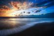 Leinwandbild Motiv beautiful sunset and waves on the beach