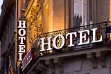 Fototapeta Fototapety Paryż - Illuminated Parisian hotel sign taken at dusk
