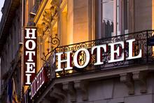 Illuminated Parisian Hotel Sign Taken At Dusk