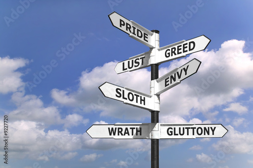 Foto Concept image of a signpost with the seven deadly sins