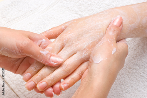 Printed kitchen splashbacks Manicure applying peeling scrub or moisturizing cream onto the hands