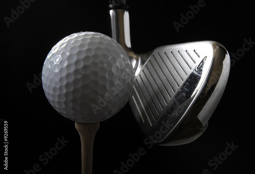 Fototapety, obrazy: Golf club with ball on a tee in the black background
