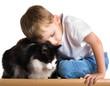 Leinwandbild Motiv Little boy embraces the cat