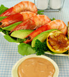Freshly prepared shrimps with rocket salad and bread