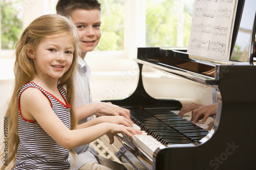 Photo  Brother And Sister Playing Piano