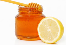 Honey Jar And Lemon Isolated On White Background