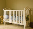 A classic white crib in a baby's room