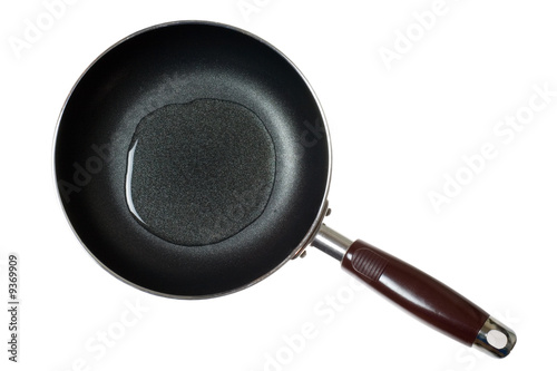 Fototapeta Frying pan with cooking oil isolated on white background.