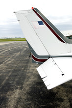 Photo Of An AirplaneÕs Wing With A Blue Sky Background