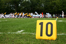 Ten Yard Line Marker With Football Play Behind