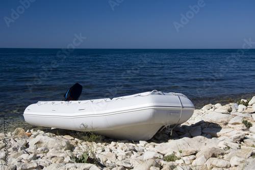 Poster Nautique motorise inflatable boat on the sea coast