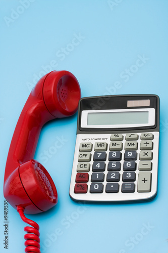 Fotografia, Obraz  Telephone with calculator – help with your financial questions