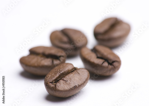 Deurstickers koffiebar Close up of group of coffee beans on white background