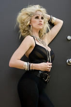 Fair-skinned Model Posing With Black Clothing And Big Blonde