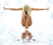 Leinwandbild Motiv artistic nudity style picture of woman on white sand