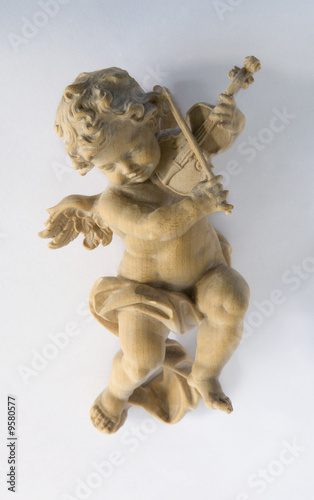 Carved wooden Xmas tree ornament:  cherub playing violin Wallpaper Mural