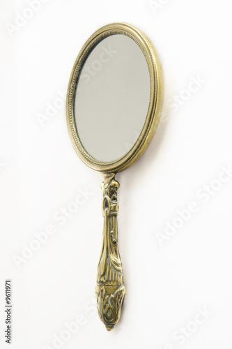 ornate hand mirror. Ornate Antique Art Deco Brass Hand-mirror. Isolated On White Ornate Hand Mirror
