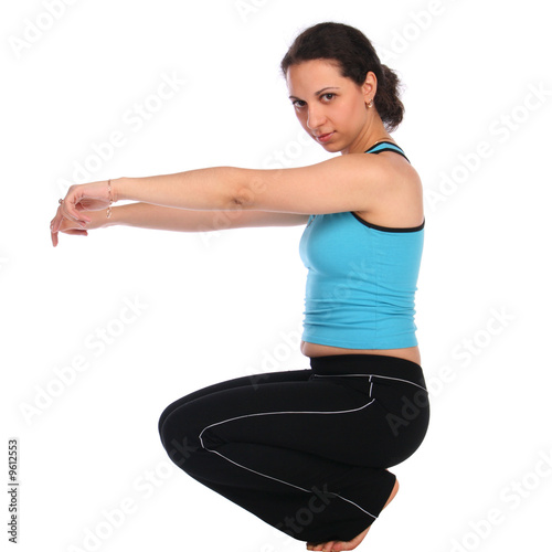 Leinwand Poster Brunet sport girl doing curtsey sideview isolated