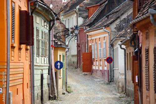 Fotografie, Obraz  colored street in sighisoara medieval town, romania
