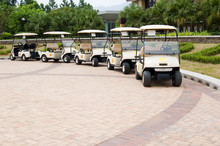 A Row Of Empty Golf Carts Waiting For Golfers At A Country Club