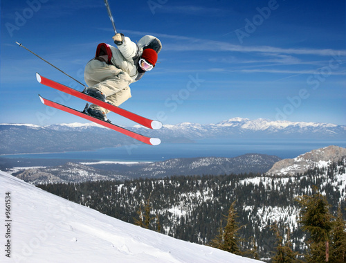 Papiers peints Glisse hiver A young man jumping high at Lake Tahoe resort