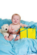 canvas print picture - Baby on a fluffy blue blanket with a big smile