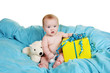 canvas print picture - Baby sitting on a blue blanket opening a present