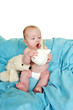 canvas print picture - Baby with a surprised look at his piggy bank