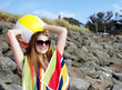 canvas print picture - Pretty brunette in sunglasses at beach
