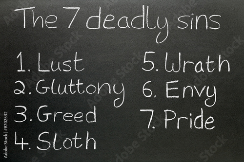 Canvas Print The seven deadly sins, written in chalk on a blackboard.