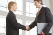 Portrait of businessmen shaking hands at meeting