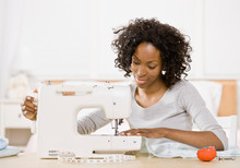 Creative Woman Using Sewing Ma...