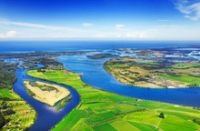 Aerial View Of Coastal Waterways, Blue Sky And Ocean