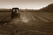 Agricultural Tractor Cultivating Land
