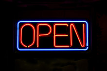 A Neon OPEN Sign Glowing Red I...