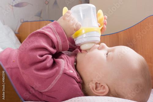 Photo  Baby drink milk from bottle