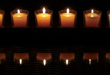 Row Of Candles In Votives