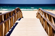 Wooden stairs on deserted beach dunes in Tarifa, Spain