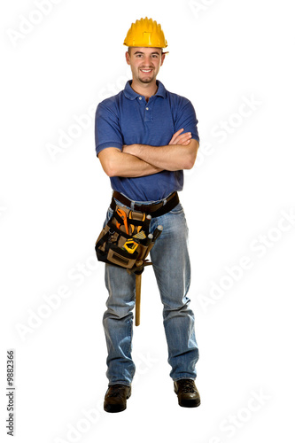 Fotografia  isolated standing young worker on white background