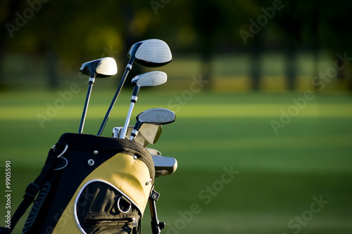 Fotografia, Obraz  A set up new golf clubs on a beautiful golf course