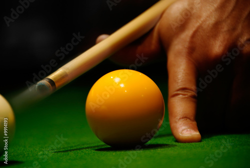 Leinwand Poster Close up of the hand of a player at billiard table with motion