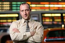 Businessman Over Stock Exchange Background