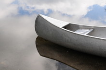 Canoe And Clouds