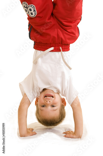 An adorable three year old doing a handstand. Wallpaper Mural