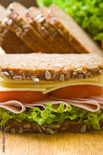 Staande foto Snack Fresh wholemeal cheese and ham sandwich