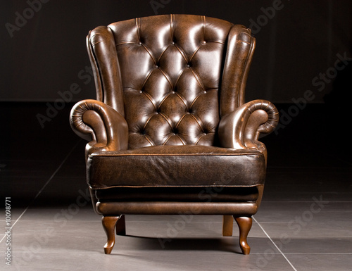 Tela Brown leather armchair on a black background