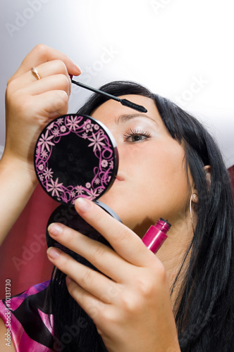 Aluminium Prints Manicure Young woman makes a makeup