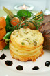Baked lamb and potato stack with onions and beans