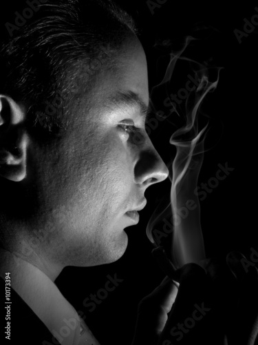 Fototapety, obrazy: Young man in suit smoking cigarette sideview